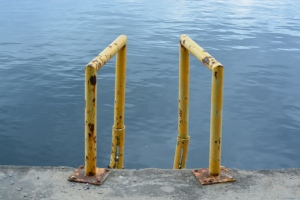 rusty ladder rail water